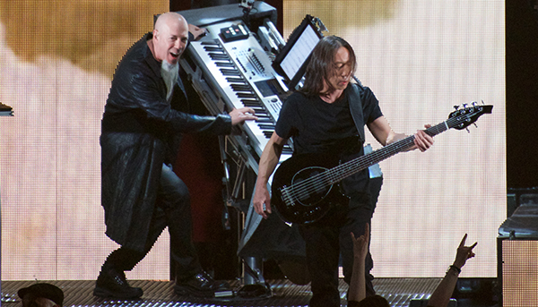 Jordan Rudess rocking out on his Korg Kronos, John Myung in front. Note the keyboard stand tilts and rotates.
